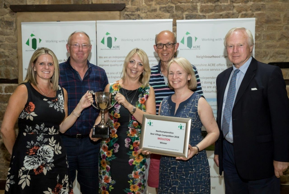 Moulton receiving their Best Village 2018 awards with David Laing